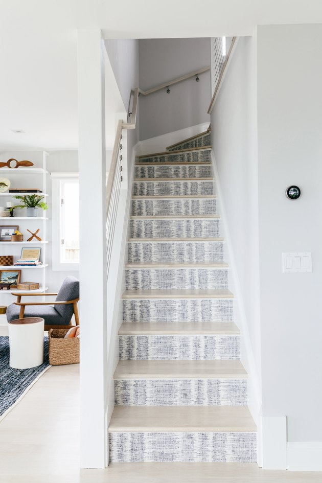 blue and white stairs wallpaper on risers