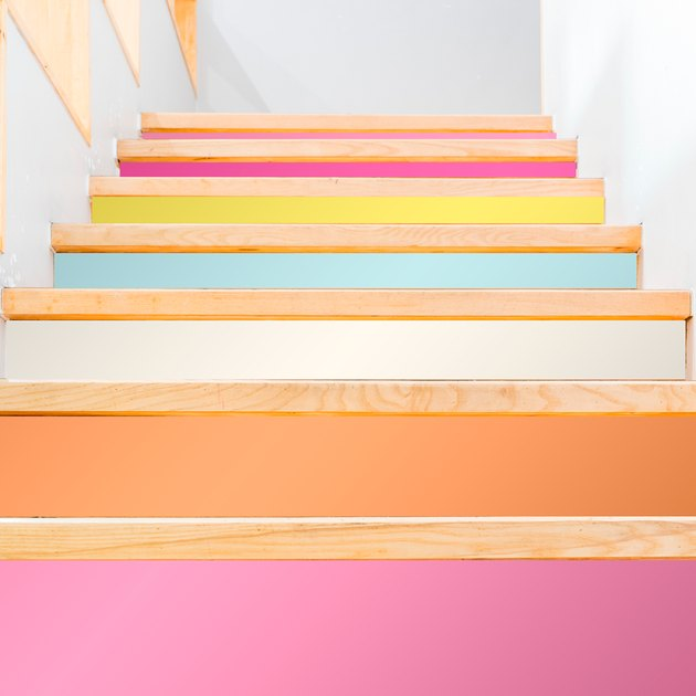 colorful stairs wallpaper on white staircase with wood treads