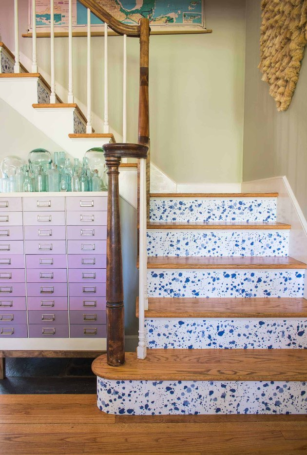 splatter stairs wallpaper on risers of staircase with wood treads