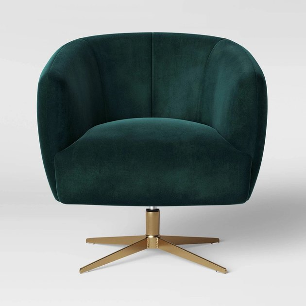 Emerald green rounded velvet swivel chair with brushed gold base