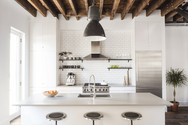 White kitchen design with wood beams