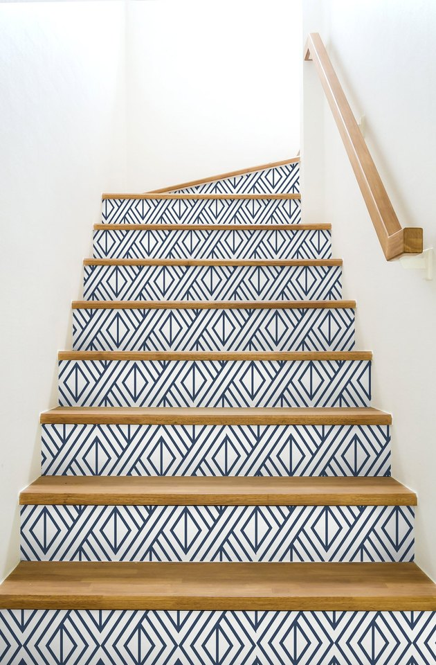 white staircase with geometric blue and white stairs wallpaper