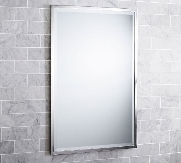 Rectangular wall mirror with thin silver border