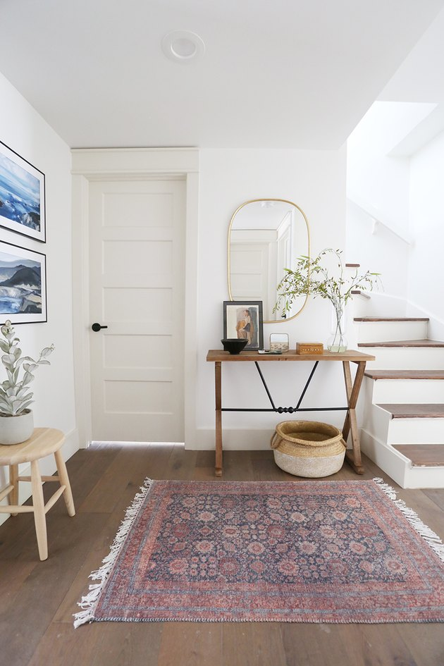 Traditional entryway table with vintage decor and artwork