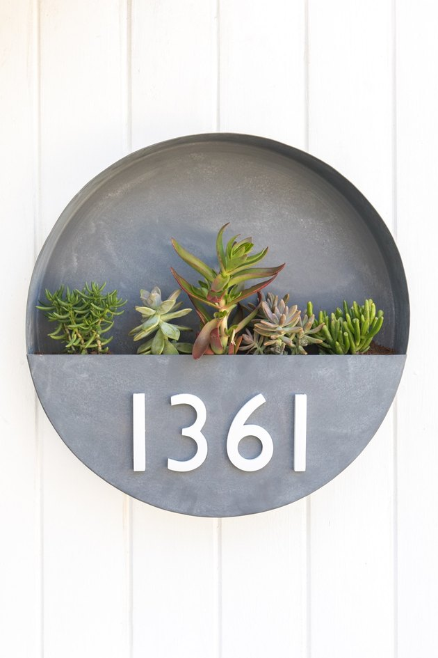 round DIY house number sign with planter