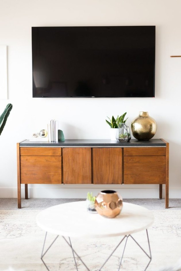 Living room storage ideas with vintage credenza