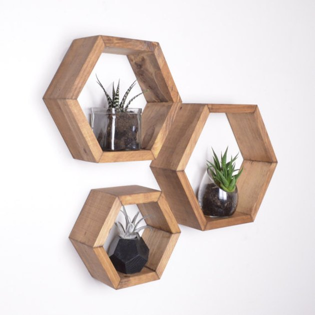 Three wooden hexagonal shelves in different sizes