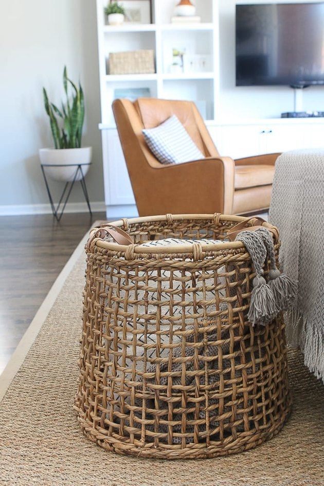 Living room storage ideas with woven basket for blankets
