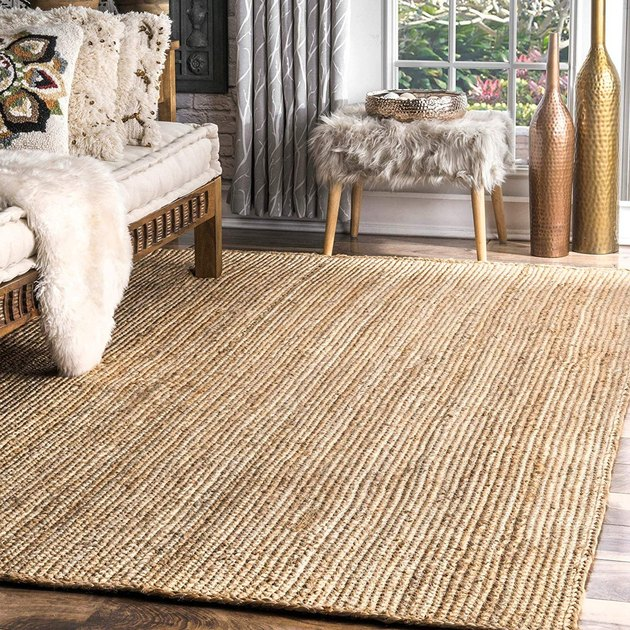 jute rug in living room with daybed and accent chair