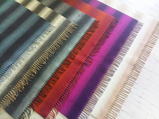 layered wool rugs with tassel fringe