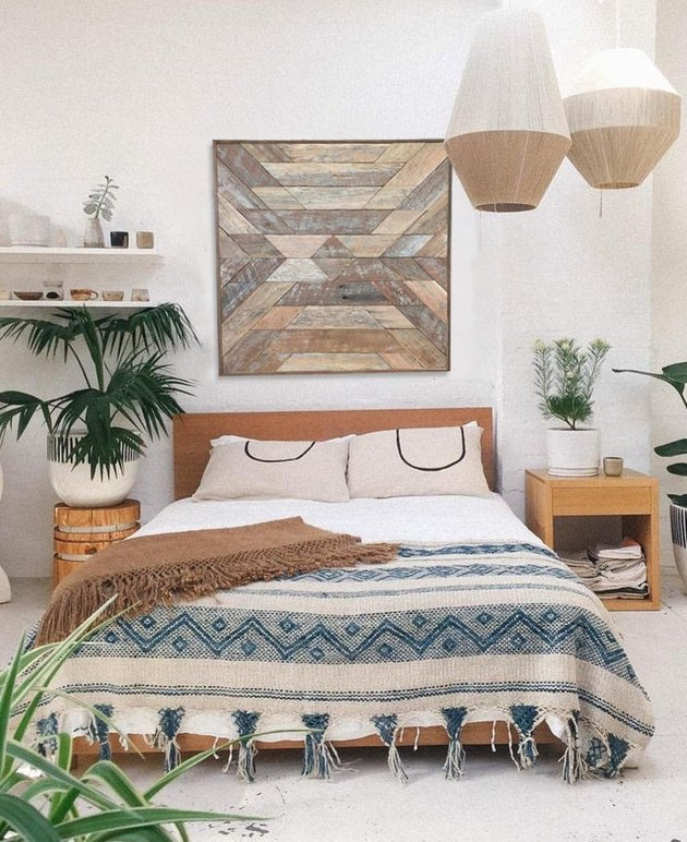 masculine boho bedroom with wooden wall art