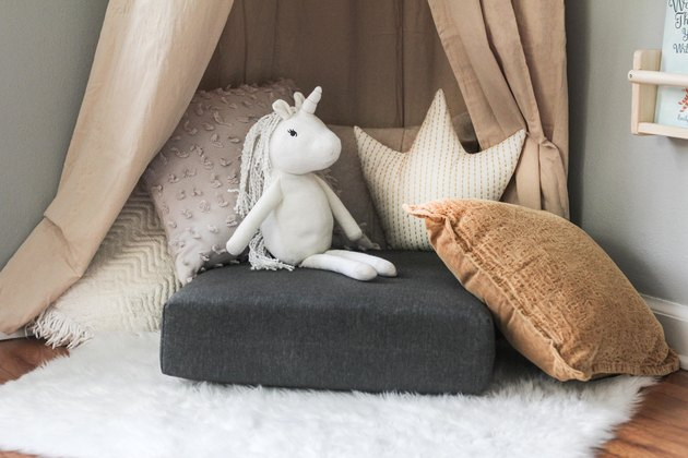Pile of pillows with stuffed unicorn