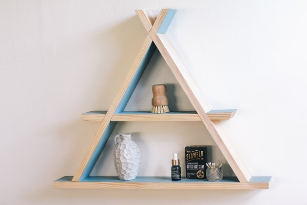 A-frame wood shelf on wall.