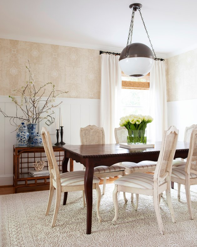 Cream and white dining room with globe-shaped traditional dining room lighting