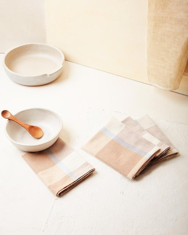 bowls with patterned napkins nearby