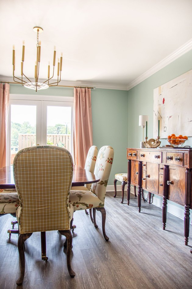 Green and pink vintage dining room with brass candelabra traditional dining room lighting