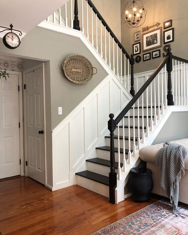 Black and white farmhouse stair railing with farmhouse decor