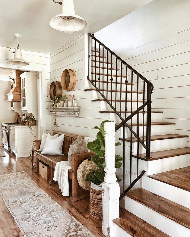 Black wrought iron farmhouse stair railing with shiplap and farmhouse decor