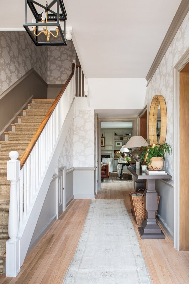White and wood farmhouse stair railing in farmhouse entryway