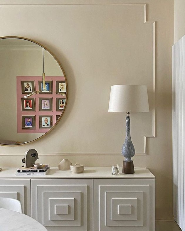beige color paneled wall with white console