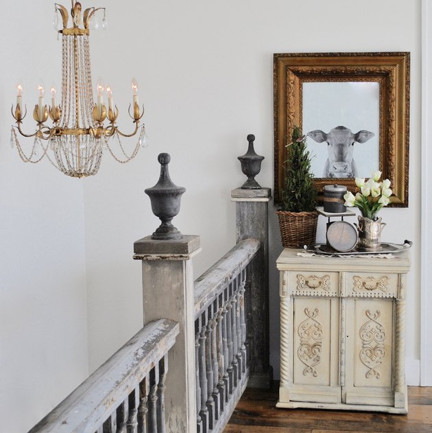 Antique farmhouse stair railing in gray chipped paint and farmhouse decor