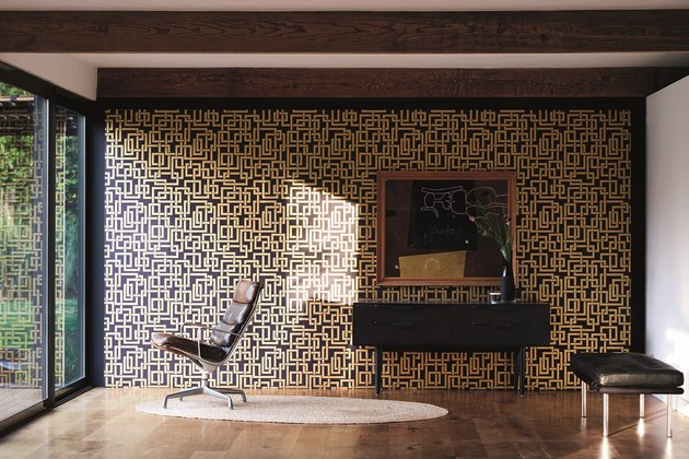 office with black-and-gold wallpaper