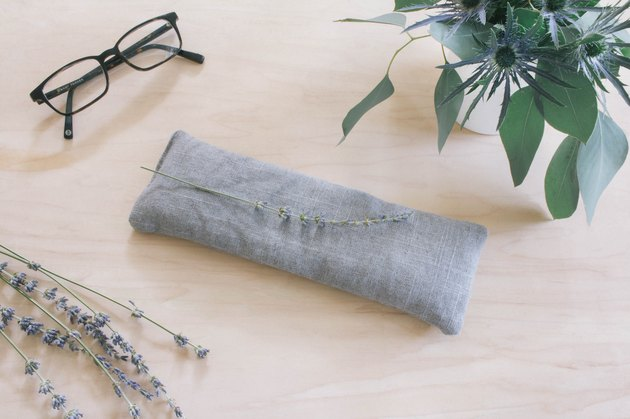 DIY lavender-fill eye pillow on bedside table.