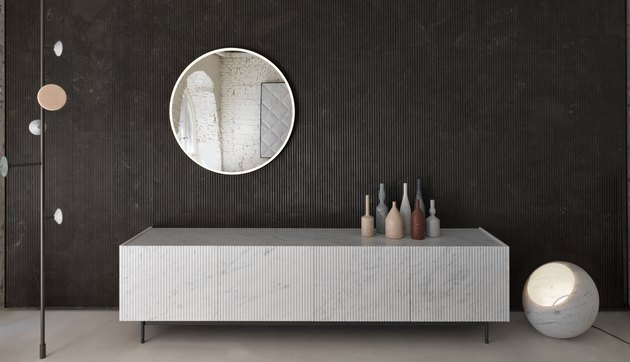 ridged natural stone vanity and wall panelling in contemporary bathroom