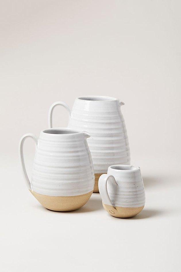 Three white pitchers farmhouse kitchen idea