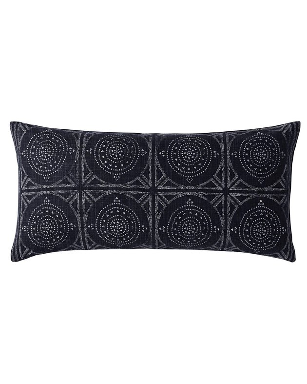 Black lumbar pillow with subtle grey design