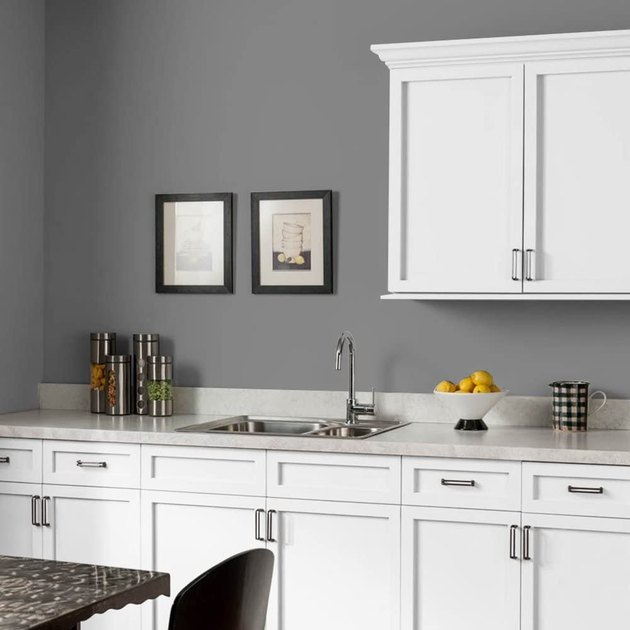 kitchen with white cabinets and gray walls