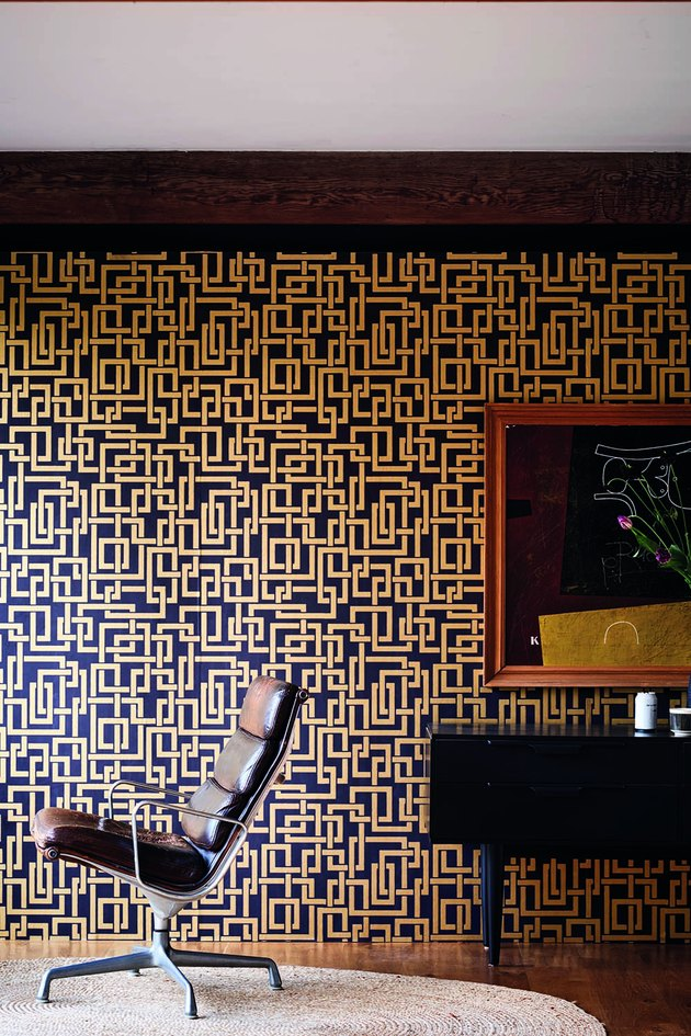 geometric black-and-gold wallpaper