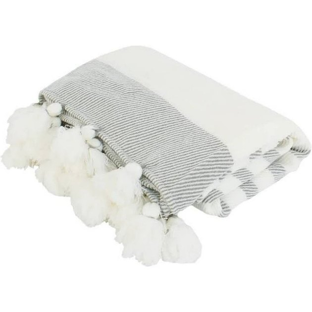 Gray and white striped throw with white fluffy tassels