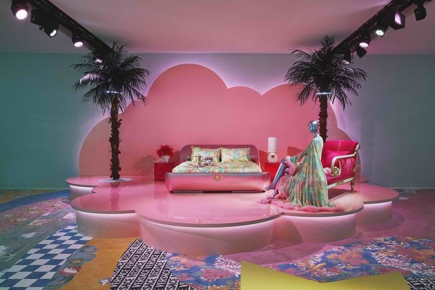 neon interiors with pink bed at Versace Home