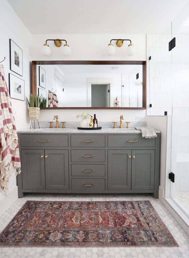 Gray traditional bathroom vanity idea with brass pulls and double sinks