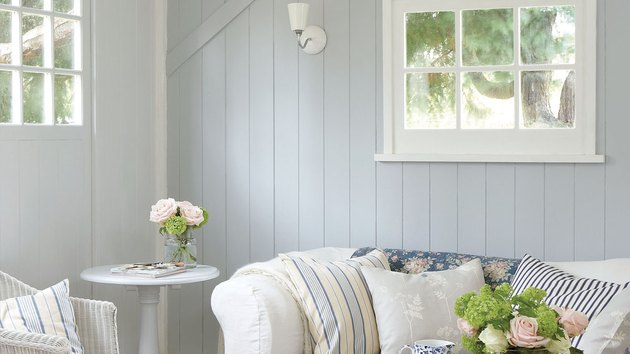 living room with gray shiplap and windows with white trim
