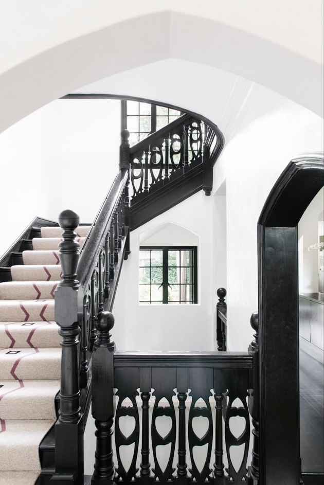 carved black stair railing