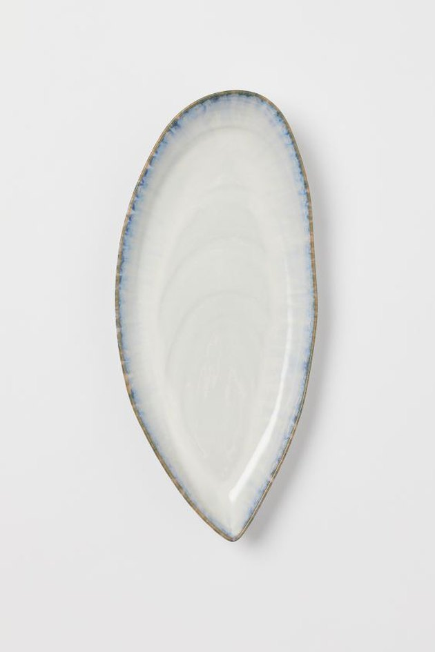 white stoneware serving dish with blue border