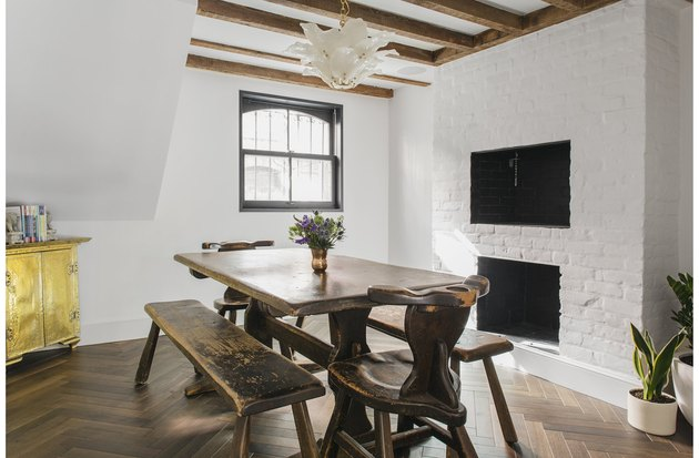 rustic basement furniture with table and exposed beams