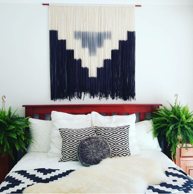 Black and cream fringed wall tapestry