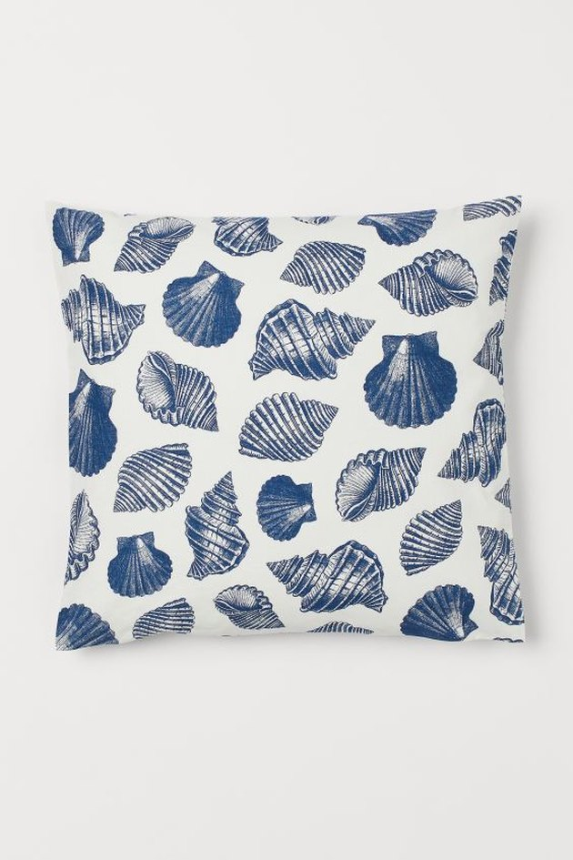 blue and white pillow with sea shell pattern