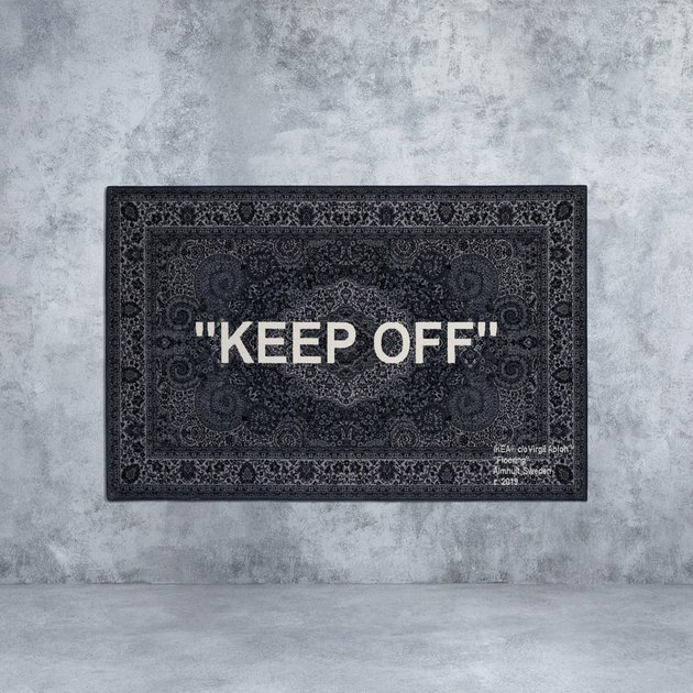 rug: black rug with KEEP OFF written on it