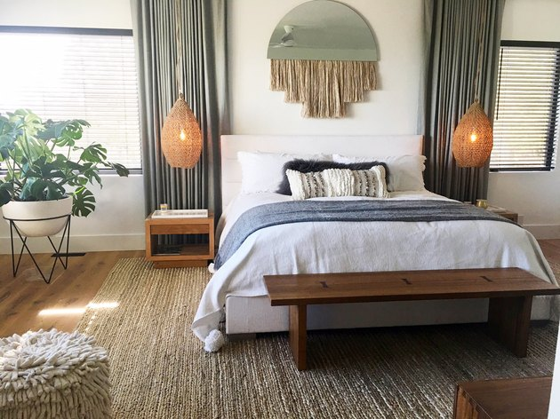 neutral bedroom idea with sage green drapery and hanging pendants
