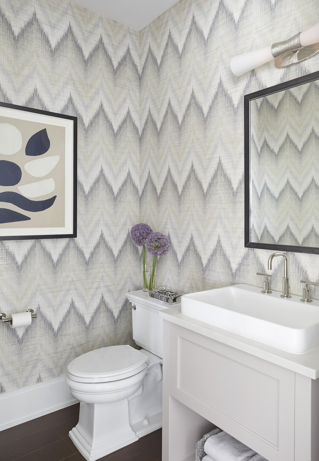 Budget bathroom remodel with patterned wallpaper