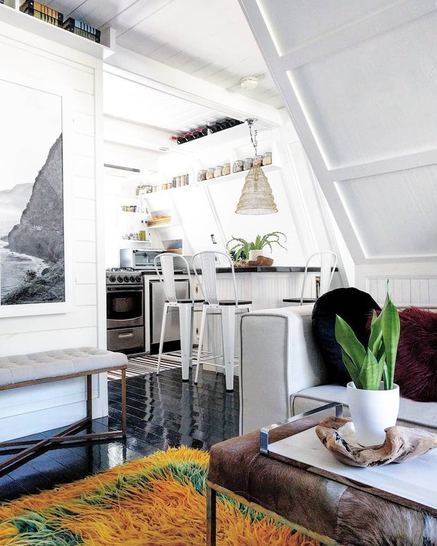 A-frame cabin with eclectic black-and-white furnishings