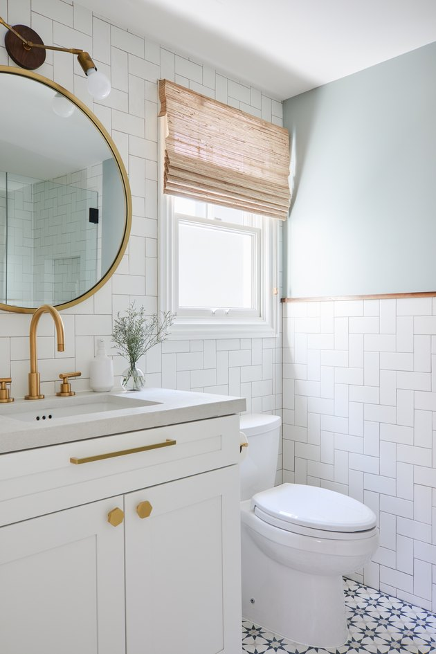 Modern white budget bathroom remodel with white wall tile and patterned floor tile