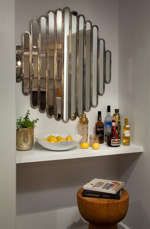 art deco decorating on a budget mirror over bar with wood stool