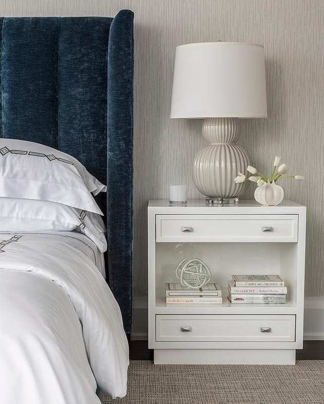 art deco decorating on a budget velvet bed frame and white nightstand