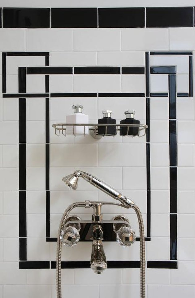 art deco decorating on a budget black and white shower tile with silver shower fixture