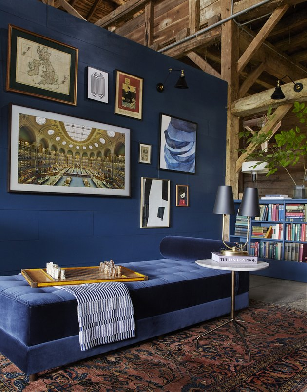 daybed in the living room idea with a blue velvet daybed against a dark blue wall